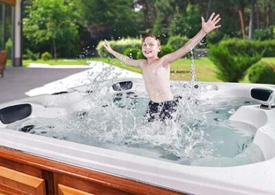 Jumping boy in an Arctic Spas hot tub